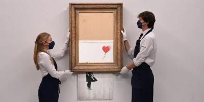 El icónico cuadro de Banksy que se autodestruyó ante los presentes en una puja, vuelve a subasta